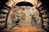 stock photo of catacombs  - Drilling in mine with hand tools  - JPG