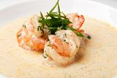 Shrimp in sauce on a white plate