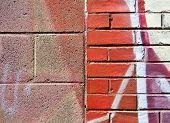 Cinder Block and Brick Wall with Graffiti