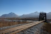 picture of trestle bridge  - Narrow railroad bridge spans river in Alaska - JPG