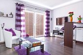 Modern white living room interior with purple decorations