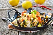 stock photo of tiger prawn  - Tasty Spanish paella with seafood and chicken breast - JPG