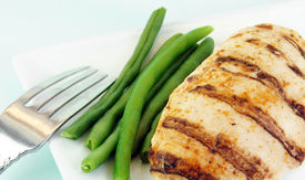 picture of green bean  - Grilled chicken breast with green beans on a white plate - JPG
