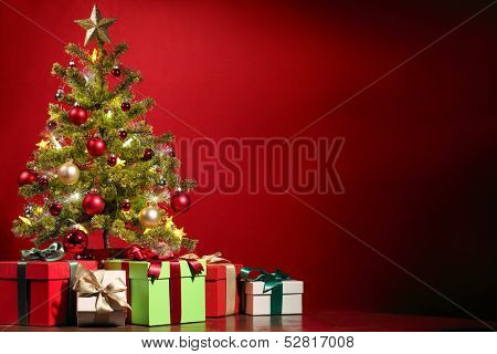 Christmas tree with gifts on red background. poster
