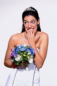 Stressed bride holding a flowers bouquet.