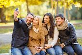 summer, holidays, vacation, travel and tourism concept - group of friends or couples having fun with