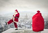 Santa Claus pulling big sack of Christmas