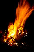 foto of braai  - Bright fire for braai with black background wood burning - JPG