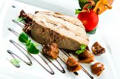 picture of chanterelle mushroom  - Sliced foie gras with sauce and chanterelle mushrooms - JPG