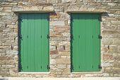 double green doors stone wall