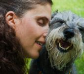 Pet owner and miniature schnauzer dog