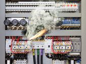 stock photo of contactor  - Overloaded electrical circuit causing electrical short and fire - JPG