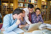 stock photo of mature adult  - Mature students sitting at the library while looking at teacher use a laptop - JPG