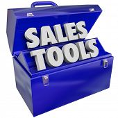 The words Sales Tools in a green metal toolbox to illustrate selling techniques, methods, schemes, p