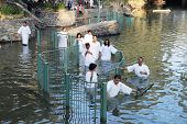 Yardenit, Israel - January 21: Christian pilgrims ritual baptism in the waters of the Jordan River i