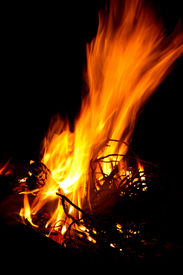 stock photo of braai  - Bright fire for braai with black background wood burning - JPG