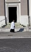 Priest Next To The Church