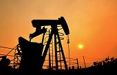 picture of crude  - old pumpjack pumping crude oil from oil well - JPG