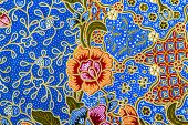 stock photo of batik  - Beautiful orange flower pattern on batik background - JPG