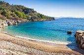 Tranquil Nissaki beach, a small cove lapped by limpid waters on the North-East coast of Corfu, Greec