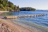 Mooring jetties  in the charming cove of Agni, on the north-eastern coast of Corfu, Greece.