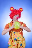 Clown Woman With A Ball On Blue Background