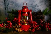 stock photo of kerosene lamp  - Red kerosene lamp on dark natural background - JPG