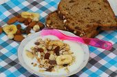 Yogurt with muesli, fruit and nuts and muesli bread