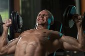Man Doing Dumbbell Incline Bench Press Workout