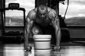 image of muscle builder  - Muscular Handsome Bodybuilder With Pills And Dope For Copy Space - JPG