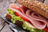 Sandwich With Ham, Cheese And Vegetables Close Up
