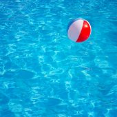 picture of pool ball  - Inflatable colorful ball floating in swimming pool - JPG