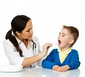 Little boy checking throat at paediatrician