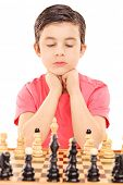 Boy playing chess isolated on white background