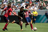 CARSON, CA - APRIL 6: Chivas USA M Mauro Rosales (7) & Los Angeles Galaxy F Robbie Keane (7) during