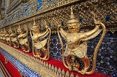 stock photo of garuda  - golden garuda statue at Wat Phra Kaew Bangkok Thailand - JPG