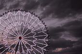 Ferris Wheel Against The Dark Sky