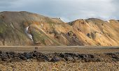 Tourists in Landmannalaugar unbelievable landscape, Iceland