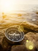 picture of longitude  - compass on the bank with lens flare - JPG