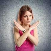 pic of nonverbal  - Redhead girl doing NO gesture over textured background - JPG