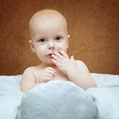 Little Boy Sitting In A Pillow