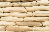 picture of sandbag  - sandbags stacked to form a wall against the flood - JPG