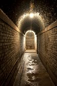 image of raid  - A lighted passageway in an air raid shelter located in Fengjing Town Shanghai China - JPG