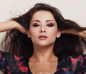Beautiful Makeup Female Model With Bright Eyes Make-up. Closeup Portrait