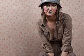 Woman In Army Hat And A  Creative Makeup