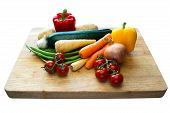 picture of phaseolus  - Vegetable selection on a wooden chopping board with an isolated background - JPG