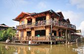 Traditional stilts wooden house and boat of Intha people