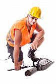 Man Assembling A Jackhammer
