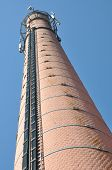 Brick chimney with cables antennas of telecommunication systems