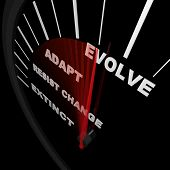 stock photo of evolve  - A speedometer tracks the progress of change with needle racing from Extinct to Evolve - JPG
